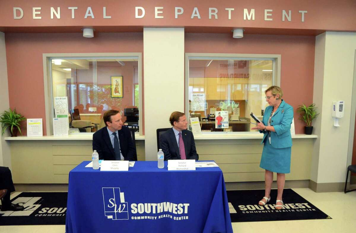 Southwest Community Health Center CEO Katherine Yacavone introduces US Senators Chris Murphy, left, and Richard Blumenthal for a forum on the recent health care bill activity in the senate in Bridgeport, Conn., on Friday June 23, 2017. The senators hosted several events around Connecticut on Friday to hear firsthand from Connecticut residents who would be harmed by the catastrophic bill.