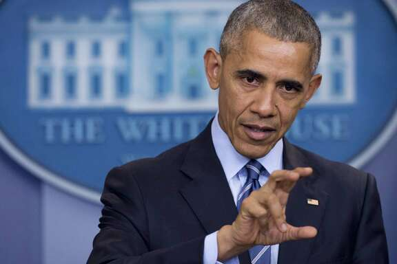 "US President Barack Obama holds a year-end press conference in the Brady Press Briefing Room of the White House in Washington, DC, December 16, 2016. Obama said Friday he had confronted Vladimir Putin in person over allegations of Russian hacking when they met ahead of the US election, telling him to ""cut it out."" / AFP PHOTO / SAUL LOEBSAUL LOEB/AFP/Getty Images"