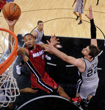 bd13b65442d7 3of4Miami Heat s Rashard Lewis shoots against San Antonio Spurs  Tiago  Splitter during first half action Sunday March 31