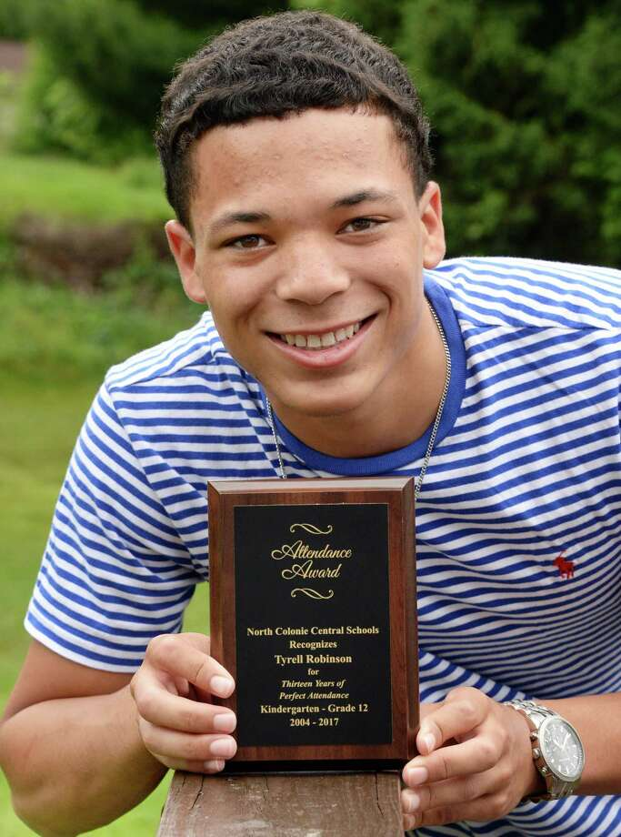 Graduating Shaker High senior Tyrell Robinson holds his award for perfect attendance record -- not for the past school year, or high school years, but for all of K-12, at his home Thursday June 22, 2017 in Colonie, NY.  (John Carl D'Annibale / Times Union) Photo: John Carl D'Annibale / 40040877A