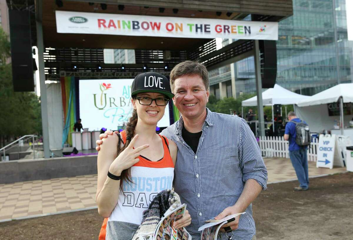 People pose for a photo at the annual Rainbow on the Green at Discovery Green musical event Friday, June 23, 2017, in Houston.
