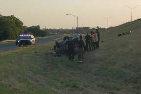 Three people were sent to the hospital with non life-threatening injuries after a car rolled due to a flat tire.