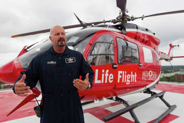 Todd Grubbs, chief pilot with Memorial Hermann Life Flight, talks about the benefits of the hospital's new roof helipad at Memorial Hermann The Woodlands Hospital, Thursday in The Woodlands.