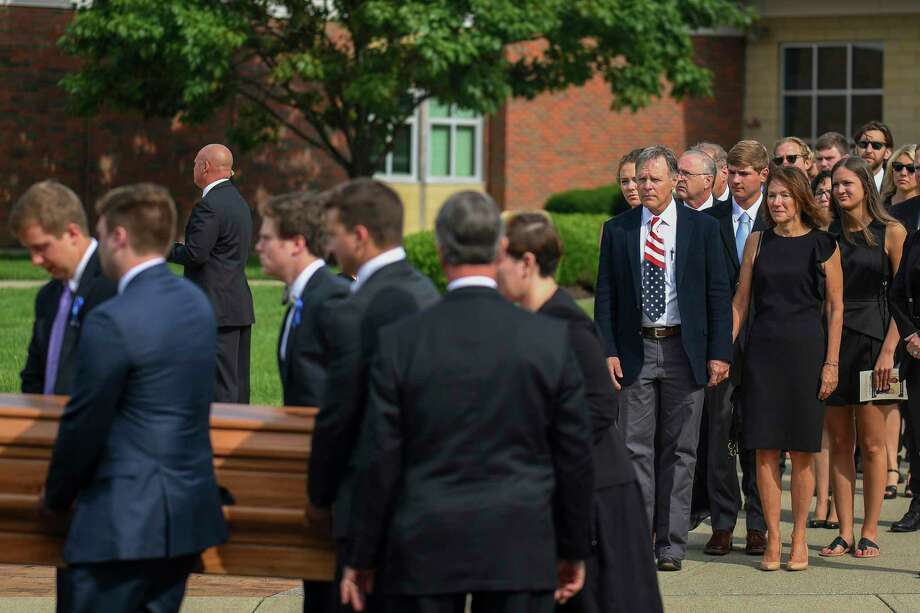 Fred and Cindy Warmbier watch as their son Otto, is placed in a hearse after his funeral, Thursday, June 22, 2017, in Wyoming, Ohio. Otto Warmbier, a 22-year-old University of Virginia student who was sentenced in March 2016 to 15 years in prison with hard labor in North Korea, died this week, days after returning to the United States. (AP Photo/Bryan Woolston) ORG XMIT: OHBW128 Photo: Bryan Woolston / FR171481 AP