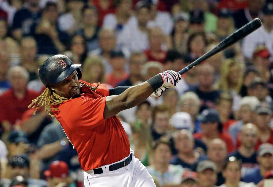 Boston Red Sox designated hitter Hanley Ramirez hits a two-run home run against the Los Angeles Angels during the fourth inning of a baseball game at Fenway Park, Friday, June 23, 2017, in Boston. (AP Photo/Elise Amendola) ORG XMIT: MAEA115 Photo: Elise Amendola / Copyright 2017 The Associated Press. All rights reserved.