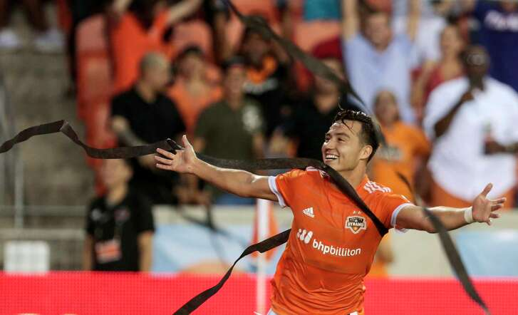 Fan-tossed streamers rain down on Dynamo forward Erick Torres as he celebrates his first-half goal against FC Dallas on Friday. A second-half goal by FC Dallas resulted in a 1-1 draw.