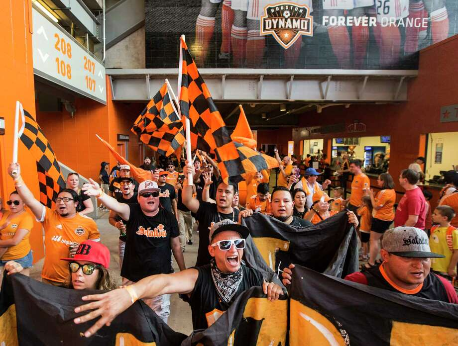 Houston Dynamo fans march into the stadium before the MLS soccer game between the Dynamo and FC Dallas at BBVA Compass Stadium on Friday, June 23, 2017, in Houston. ( Brett Coomer / Houston Chronicle ) Photo: Brett Coomer, Staff / © 2017 Houston Chronicle