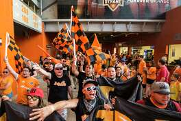 Houston Dynamo fans march into the stadium before the MLS soccer game between the Dynamo and FC Dallas at BBVA Compass Stadium on Friday, June 23, 2017, in Houston. ( Brett Coomer / Houston Chronicle )