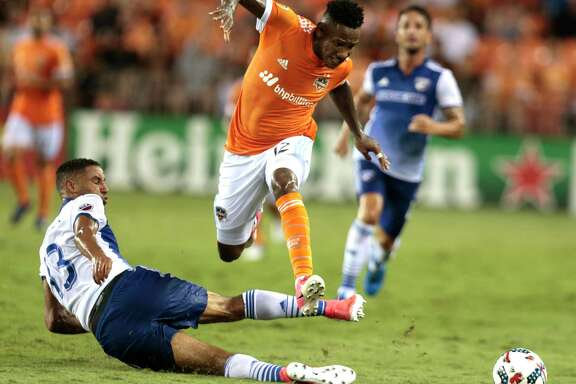 Dynamo forward Romell Quioto leaps over FC Dallas forward Tesho Akindele going after a ball during the first half of Friday's draw at BBVA Compass Stadium. The teams remain tied for second in the Western Conference.