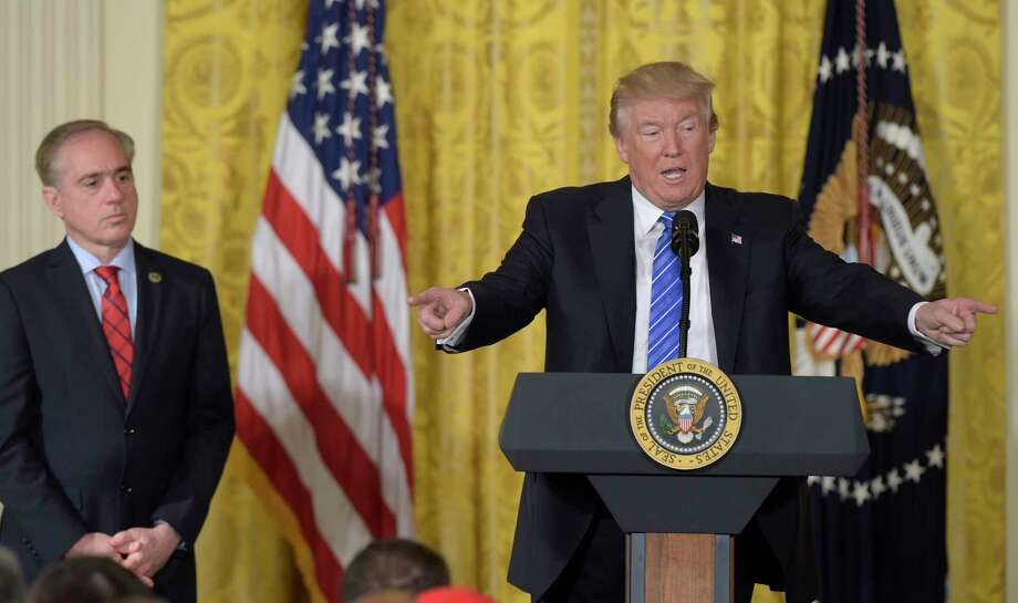 """President Donald Trump, right, standing with Veterans Affairs Secretary David Shulkin, left, speaks during a bill signing event for the """"Department of Veterans Affairs Accountability and Whistleblower Protection Act of 2017,"""" in the East Room of the White House, in Washington, Friday, June 23, 2017. (AP Photo/Susan Walsh) ORG XMIT: DCSW103 Photo: Susan Walsh / Copyright 2017 The Associated Press. All rights reserved."""