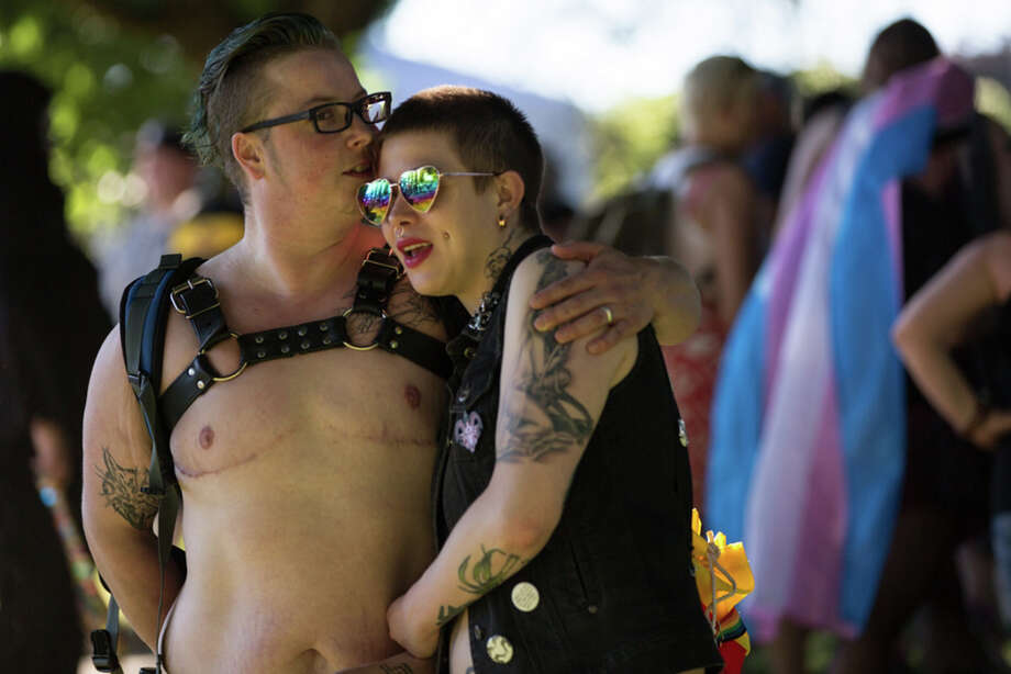 A couple embraces following Trans Pride Seattle's march in Capitol Hill on Friday, June 23, 2017 Photo: GRANT HINDSLEY, SEATTLEPI.COM / SEATTLEPI.COM