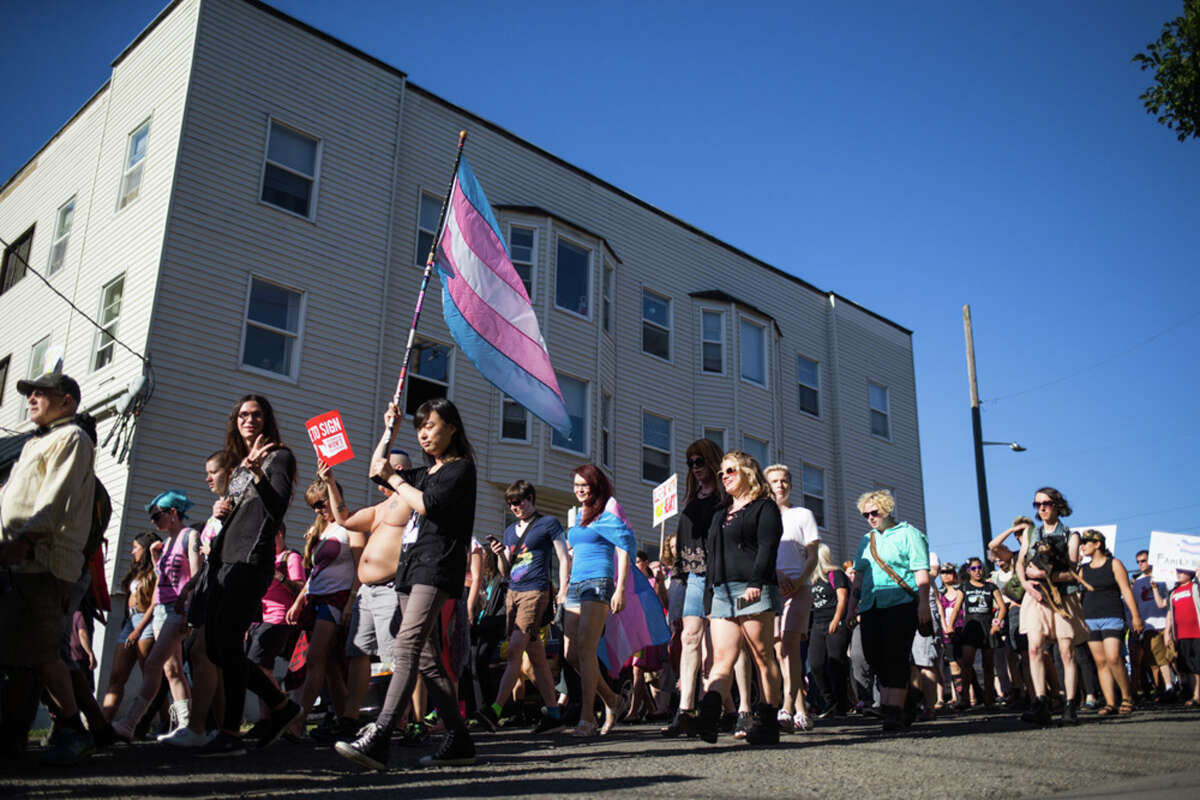 Hundreds of demonstrators march to show their support for the trans community during Trans Pride Seattle's march in Capitol Hill.