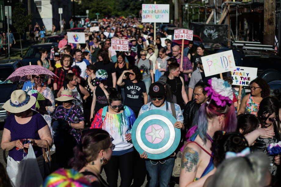 Trans Pride Seattle march participants walk into Cal Anderson Park for the rest of the festival on Friday, June 23, 2017. President Trump wants to ban transgender Americans from serving in the U.S. armed forces. Photo: GRANT HINDSLEY, SEATTLEPI.COM / SEATTLEPI.COM