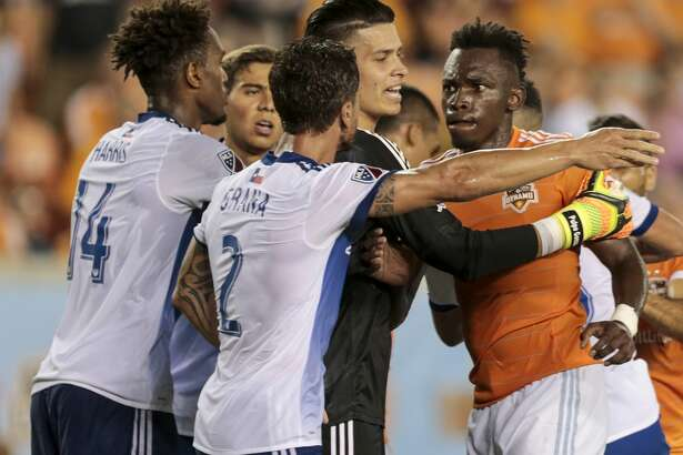 Houston Dynamo forward Alberth Elis (17) gets into an altercation with FC Dallas forward Atiba Harris (14) and Dallas defender Hernan Grana (2) during the second half of an MLS soccer game at BBVA Compass Stadium on Friday, June 23, 2017, in Houston. The match ended in a 1-1 draw. ( Brett Coomer / Houston Chronicle )