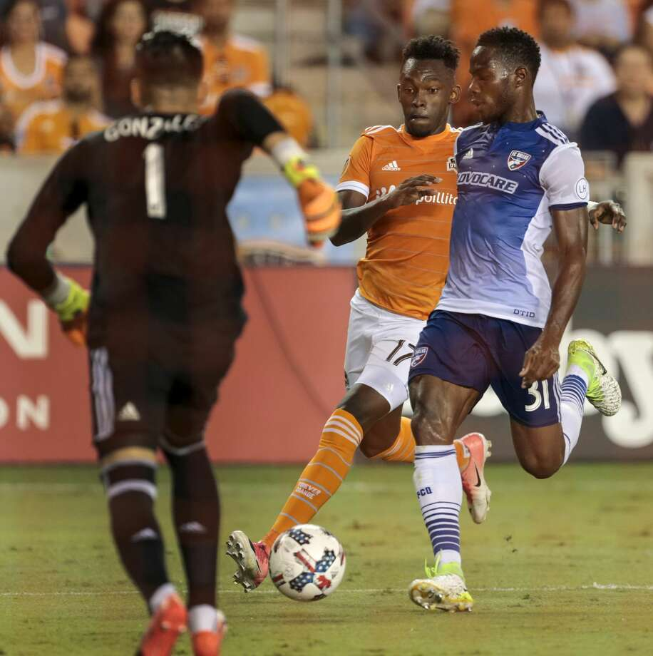 Houston Dynamo forward Alberth Elis (17) and FC Dallas defender Maynor Figueroa (31) battle for the ball as FC Dallas goalkeeper Jesse Gonzalez (1) comes out to defend the goal during the second half of an MLS soccer game at BBVA Compass Stadium on Friday, June 23, 2017, in Houston. The match ended in a 1-1 draw. ( Brett Coomer / Houston Chronicle ) Photo: Brett Coomer/Houston Chronicle