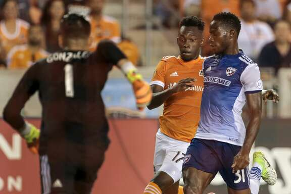 Houston Dynamo forward Alberth Elis (17) and FC Dallas defender Maynor Figueroa (31) battle for the ball as FC Dallas goalkeeper Jesse Gonzalez (1) comes out to defend the goal during the second half of an MLS soccer game at BBVA Compass Stadium on Friday, June 23, 2017, in Houston. The match ended in a 1-1 draw. ( Brett Coomer / Houston Chronicle )