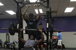 Chest press was one of many exercises that Wildcat athletes did in the weight room portion of the strength and conditioning camp
