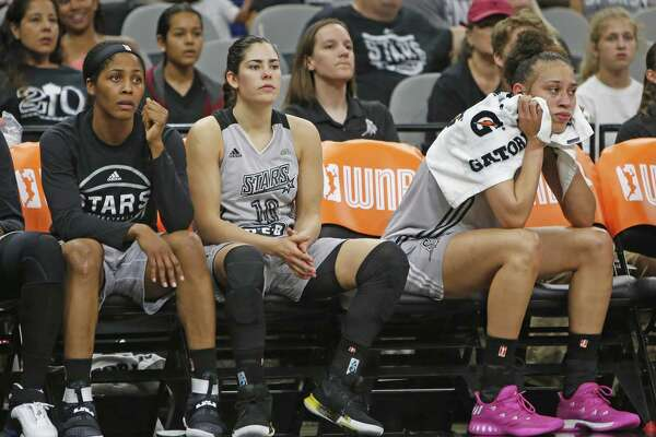 StarsÕ Dearica Hamby,far right,StarsÕ Kelsey Plum,c, and StarsÕ Sydney Colson, far left watch closing minutes of game from the Stars' home WNBA game vs. Dallas on Friday, June 23, 2017.