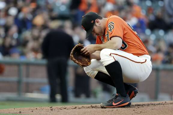 San Francisco Giants starting pitcher Ty Blach kneels on the mound before the start of the second inning of the team's baseball game against the New York Mets on Friday, June 23, 2017, in San Francisco. (AP Photo/Marcio Jose Sanchez)
