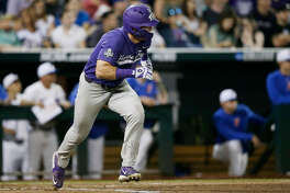 TCU's Austen Wade runs to first base, where he was safe on a play at another base during the sixth inning of the team's NCAA College World Series baseball game against Florida in Omaha, Neb., Friday, June 23, 2017. (AP Photo/Nati Harnik)