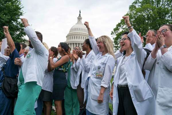Health care workers join Nancy Pelosi, the House Minority Leader, for a demonstration outside the Capitol in Washington, June 22, 2017. Senate Republicans took a major step Thursday toward repealing and replacing the Affordable Care Act, unveiling a bill that would make deep cuts to Medicaid and end the mandate that most Americans have health insurance. (Doug Mills/The New York Times)