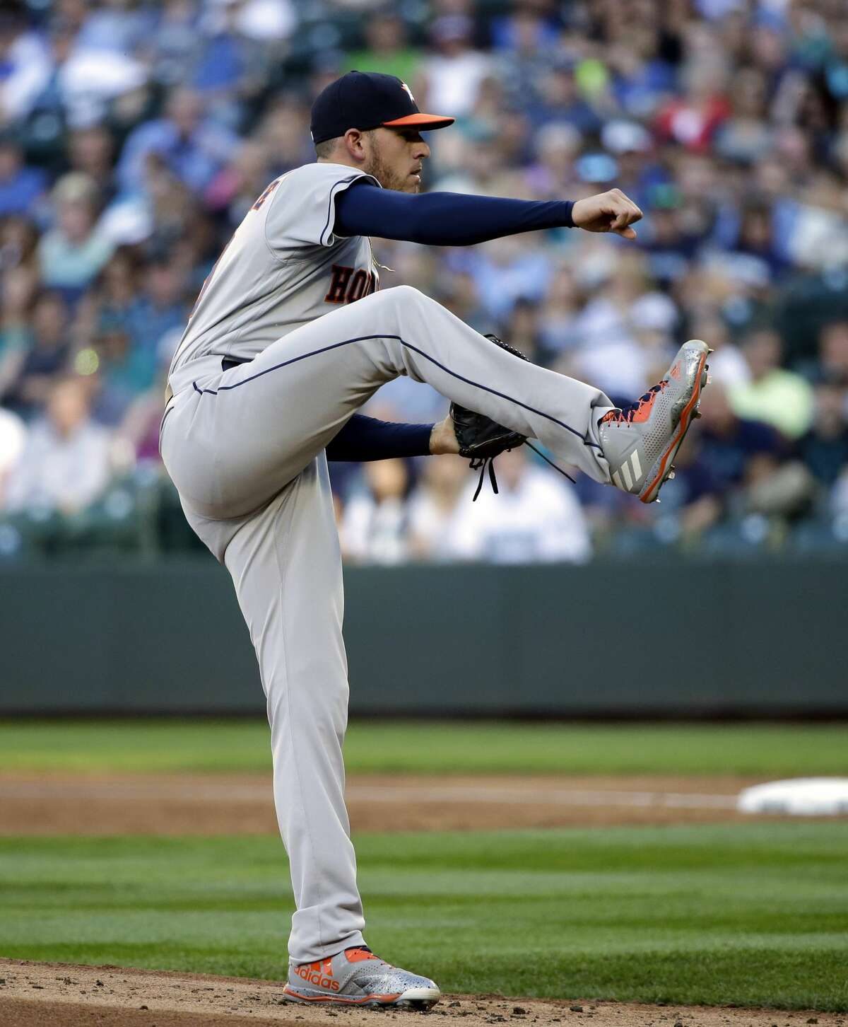Houston Astros starting pitcher Joe Musgrove follows-through as he throws against the Seattle Mariners in the first inning of a baseball game Friday, June 23, 2017, in Seattle. (AP Photo/Elaine Thompson)