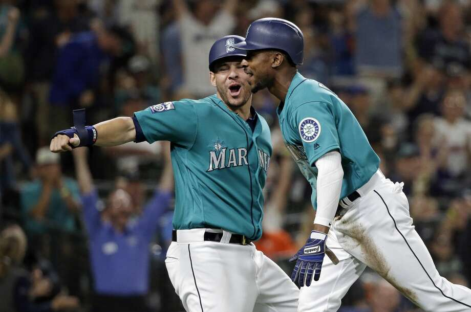 Seattle Mariners' Danny Valencia, left, and Jarrod Dyson react after both scored on a wild pitch against the Houston Astros in the seventh inning of a baseball game Friday, June 23, 2017, in Seattle. (AP Photo/Elaine Thompson) Photo: Elaine Thompson/Associated Press