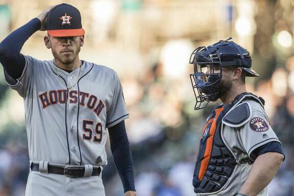 SEATTLE, WA - JUNE 23: Starting pitcher Joe Musgrove #59 of the Houston Astros and catcher Brian McCann #16 of the Houston Astros meet at the pitcher's mound during the third inning of a game against the Seattle Mariners at Safeco Field on June 23, 2017 in Seattle, Washington. (Photo by Stephen Brashear/Getty Images)