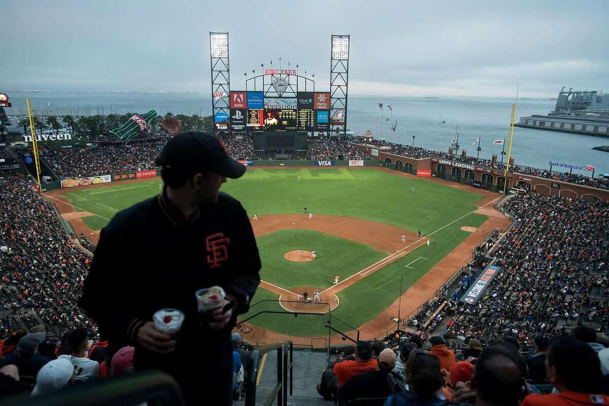 A Giants fan makes his way to upper deck seats as the Giants trail the Mets on Friday, June 23, 2017, in San Francisco.