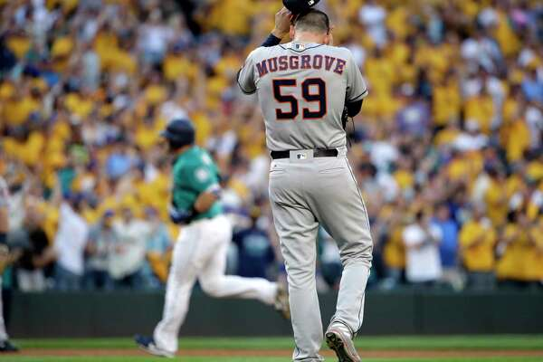 Joe Musgrove pulls off his cap as he waits for Mariners catcher Mike Zunino to round the bases on a three-run homer during the third inning Friday night in Seattle. Musgrove allowed nine runs on 12 hits in 32⁄3 innings, inflating his ERA to 6.01 this season.