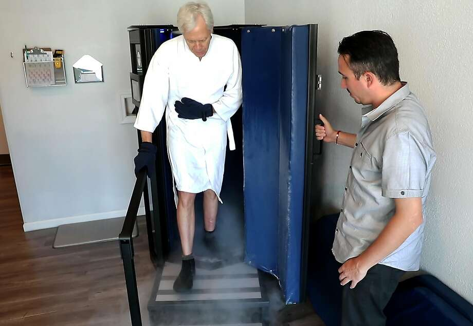 San Francisco Chronicle columnist Scott Ostler steps out of a cryotherapy chamber after he tried out the latest trend in sports health therapy called cryotherapy. Athletes from various Bay Area teams are turning to the liquid nitrogen low temp treatment to relieve inflammation and help heal injuries quicker. Photo: Carlos Avila Gonzalez, The Chronicle