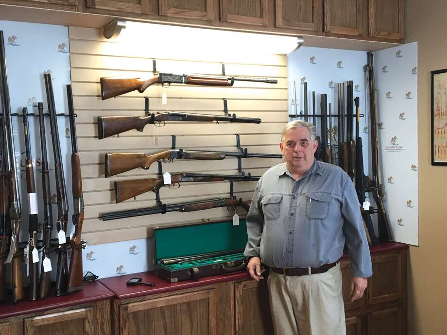 Terry Bast, owner of Goshen Guns, stands in front of a display of rare and antique shotguns. Goshen Guns recently opened at 214 South Main St. The shop offers a wide range of guns for both first-time gun owners to avid enthusiasts and collectors. Photo: John Sommerhof • Jsommerhof@edwpub.net
