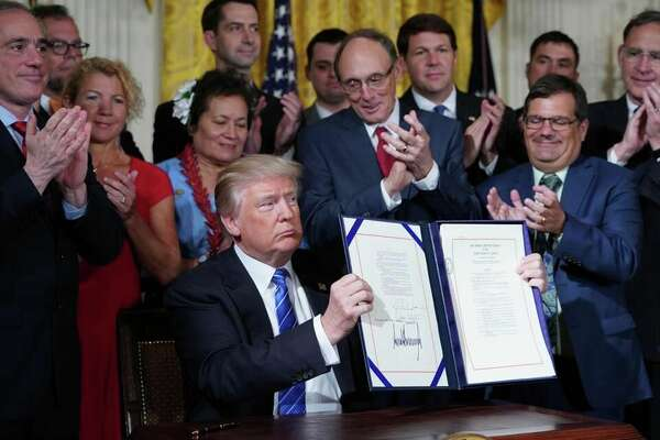 U.S. Rep. Jodey Arrington (back row, third from right) was on hand Friday when President Donald Trump signed a bill Arrington co-sponsored designed to make the Department of Veterans Affairs more accountable for veterans' health care.