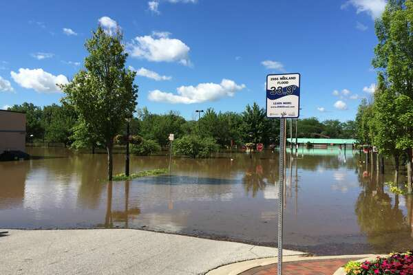 Rising waters from the Tittabawassee River hit downtown Midland as the river neared its projected crest of 31 feet on Saturday, June 24, 2017. This photo was taken at Ashman and Ann streets.