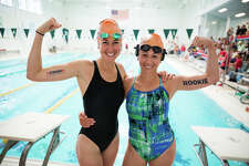Michaela Colbert and Emma Kramer show off their tattoos at the 11th annual Swim Across America Greenwich-Stamford Swim in Greenwich on Saturday, June 24, 2017. The event  was originally scheduled to talk place at Cummings Point in Stamford but due to the rain, was moved indoors to the Boys & Girls Club in Greenwich. The event  was held in part of a national effort to raise money and awareness in the fight against cancer.
