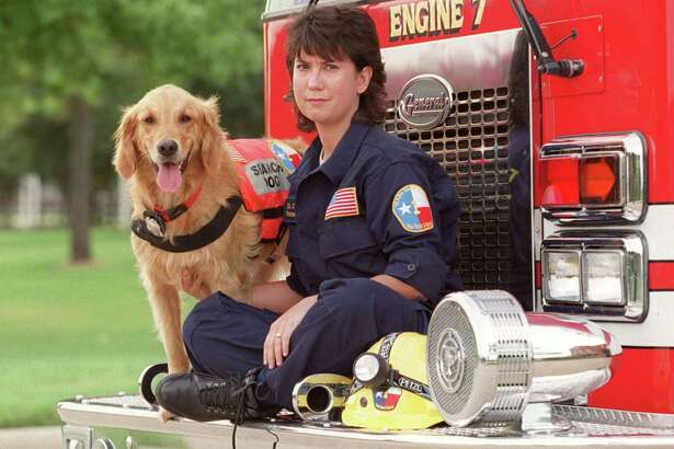 This Sept. 11, 2002, photo shows, K9 Search Specialist Denise Corliss and her search dog Bretagne in Houston, Texas. Bretagne the last known living 9/11 search dog has died in a Houston suburb at age 16. Bretagne was 2 years old when she and her handler, Corliss, were part of the Texas Task Force 1 sent to the World Trade Center site in Lower Manhattan after the terrorist attack brought down the buildings on Sept. 11, 2001. (D Fahleson/Houston Chronicle via AP) MANDATORY CREDIT