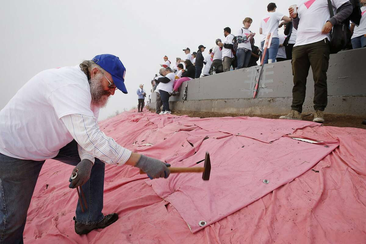 Mark Huebner installs the Pink Triangle at Twin Peaks on Saturday, June 24, 2017, in San Francisco, Calif. The Pink Triangle is a remembrance of the years of discrimination and physical attacks on the LGBT community.