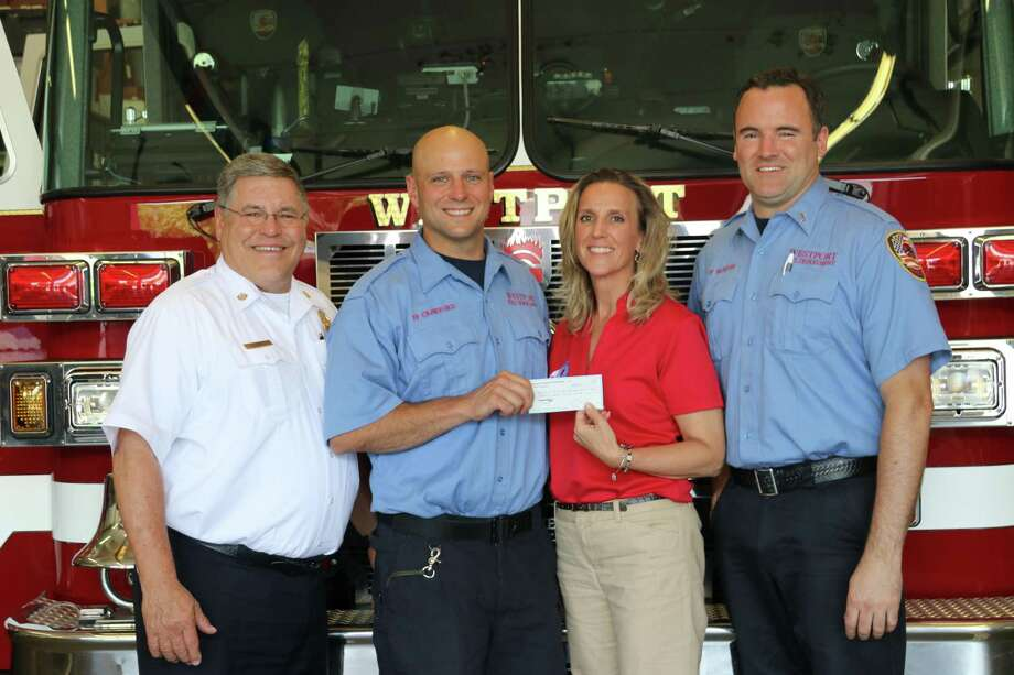 "Photo from left to right: Deputy Chief Robert Kepchar; Firefighter Theodore Crawford, President WUFCF; Kathleen Gerrity, Executive Director CT Burns Care Foundation ""Childrens Burn Camp; Lieutenant Brendan McHugh. Photo: Contributed Photo / Westport Fire Department"