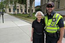 Catherine Quoma is 91, and the oldest waitress in Connecticut. She really appreciates the policemen in town and all the do to keep Greenwich safe, she said. Here she stands with Officer Andrew Greco, giving him a quick break from directing traffic in the hot sun.