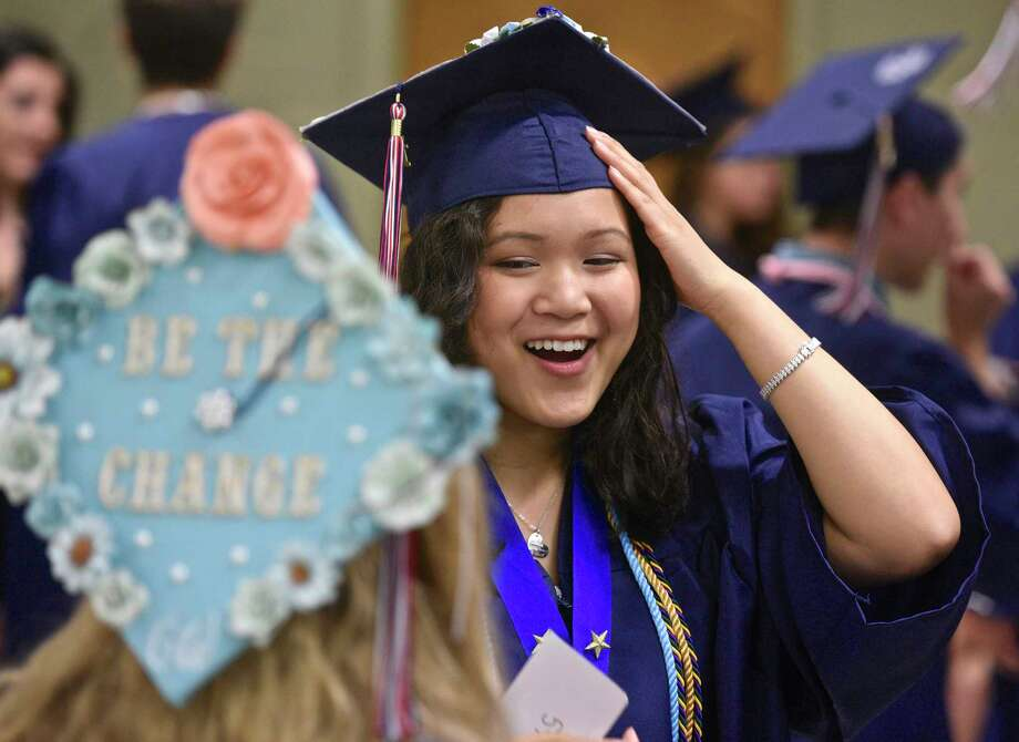Amanda Connelly, right, talks with class mate Nicole Cennamo before the New Fairfield High School Forty-second Commencement Exercises, the Class of 2017, held at the William O'Neill Center, Western Connecticut State University, Saturday morning, June 24, 2017, in Danbury, Conn. Photo: H John Voorhees III, Hearst Connecticut Media / The News-Times