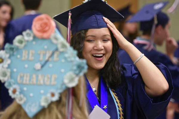 Amanda Connelly, right, talks with class mate Nicole Cennamo before the New Fairfield High School Forty-second Commencement Exercises, the Class of 2017, held at the William O'Neill Center, Western Connecticut State University, Saturday morning, June 24, 2017, in Danbury, Conn.