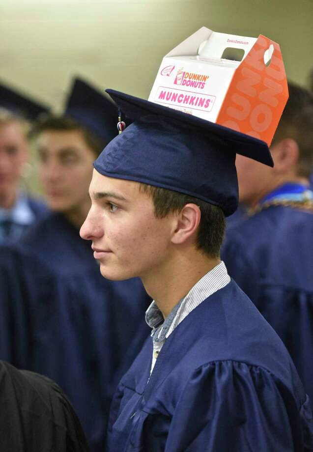 Jake Costanzo carried his breakfast on his cap during the New Fairfield High School Forty-second Commencement Exercises, the Class of 2017, held at the William O'Neill Center, Western Connecticut State University, Saturday morning, June 24, 2017, in Danbury, Conn. Photo: H John Voorhees III, Hearst Connecticut Media / The News-Times