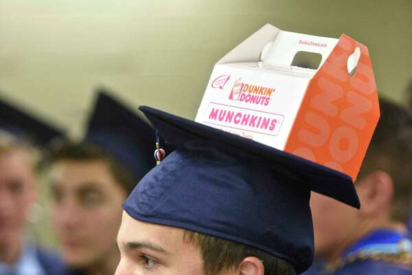 Jake Costanzo carried his breakfast on his cap during the New Fairfield High School Forty-second Commencement Exercises, the Class of 2017, held at the William O'Neill Center, Western Connecticut State University, Saturday morning, June 24, 2017, in Danbury, Conn.