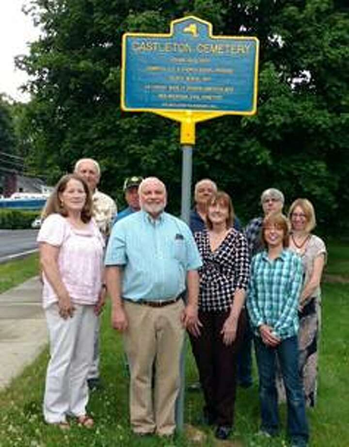 Trustees of the Castleton Cemetery Association unveil a historical marker at Mountain View Cemetery, Scott Avenue, in Castleton-on-Hudson. The association was able to obtain the marker with help from the village and town of Schodack. The cemetery association was incorporated in 1855 by combining the Old & Church Burial Grounds. The oldest burial is from 1811 and includes veterans back to the Spanish-American War. The cemetery is also the largest green space in the village. Shown at the unveiling are Jayne Robinson, Frank Ball, Vincent Brewer, Norman Wiley, Phillip Dorn, Dawne Kelly, Steve Kelly, Bonnie Bauer and Jenifer Practico. (Not pictured, Barbara Maxam, Jerry Robinson and Marianne Carner.)