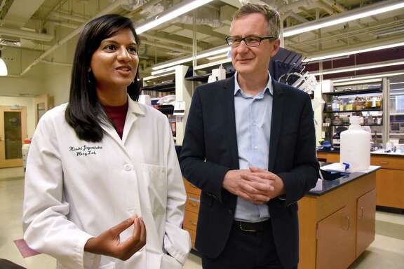 "Hasini Jayatilaka, left, and Denis Wirtz discuss their discovery that a biochemical signaling process that causes the spread of cancer cells can be slowed down with a ""drug cocktail."""