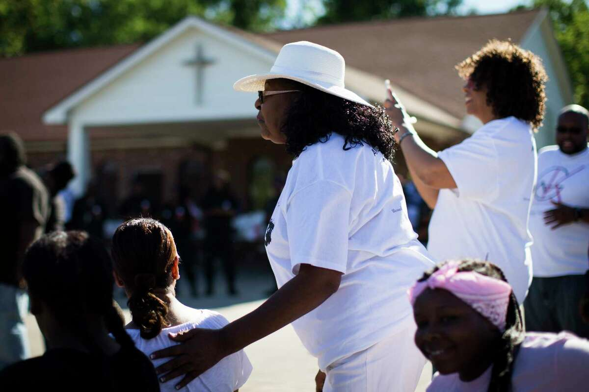 Betty Hampton, an ambassador against violence, greets friends during an event intended to heal and get the community involved against crime after two people were shot in March at the Haverstock Hills apartments. Sunday, April 30, 2017, in Houston. ( Marie D. De Jesus / Houston Chronicle )