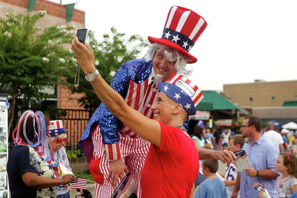 In this file image from July 4, 2015, Denise Aoun, right, takes a selfie with Ryan Magnuson before the Star Spangled Salute at The Cynthia Woods Mitchell Pavilion Friday. More than 11,000 visitors enjoyed music from the Houston Symphony during the annual event.