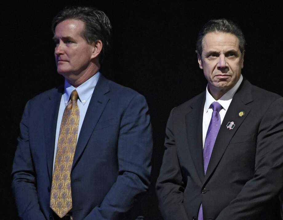 Governor Andrew Cuomo stands with Senate Majority Leader John Flanagan, left, before his presentation of the State of the State message at the Convention Center at the Empire Plaza Wednesday Jan. 13, 2016 in Albany, N.Y. (Skip Dickstein/Times Union) ORG XMIT: MER2016011315334550 Photo: SKIP DICKSTEIN / 10034976A