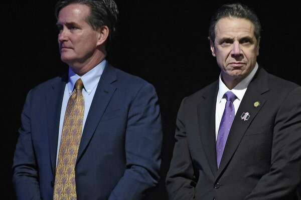 Governor Andrew Cuomo stands with Senate Majority Leader John Flanagan, left, before his presentation of the State of the State message at the Convention Center at the Empire Plaza Wednesday Jan. 13, 2016 in Albany, N.Y. (Skip Dickstein/Times Union) ORG XMIT: MER2016011315334550