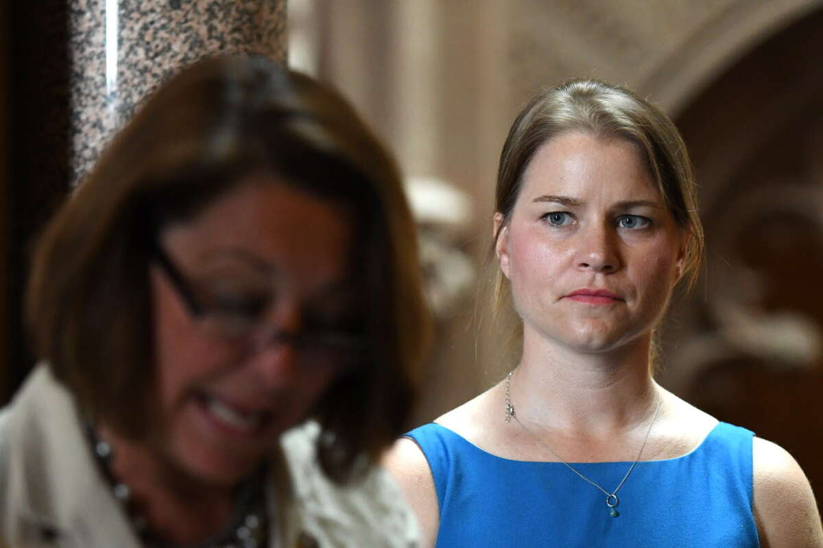 Bridie Farrell, Olympic athlete and childhood sexual abuse survivor, right, listens as Saratoga Springs mayor Joanne Yepsen, left, speaks during a press conference where advocates urged for passage of the Child Victim's Act on Monday, June 19, 2017, at the Capitol in Albany, N.Y. (Will Waldron/Times Union)